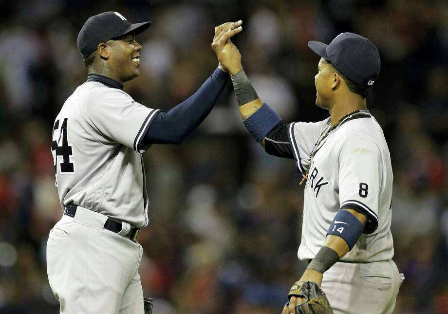 Yankees relief pitcher Aroldis Chapman, left, and Starlin Castro celebrate after the Yankees beat the Indians on Thursday. Photo: Tony Dejak — The Associated Press  / AP 2016
