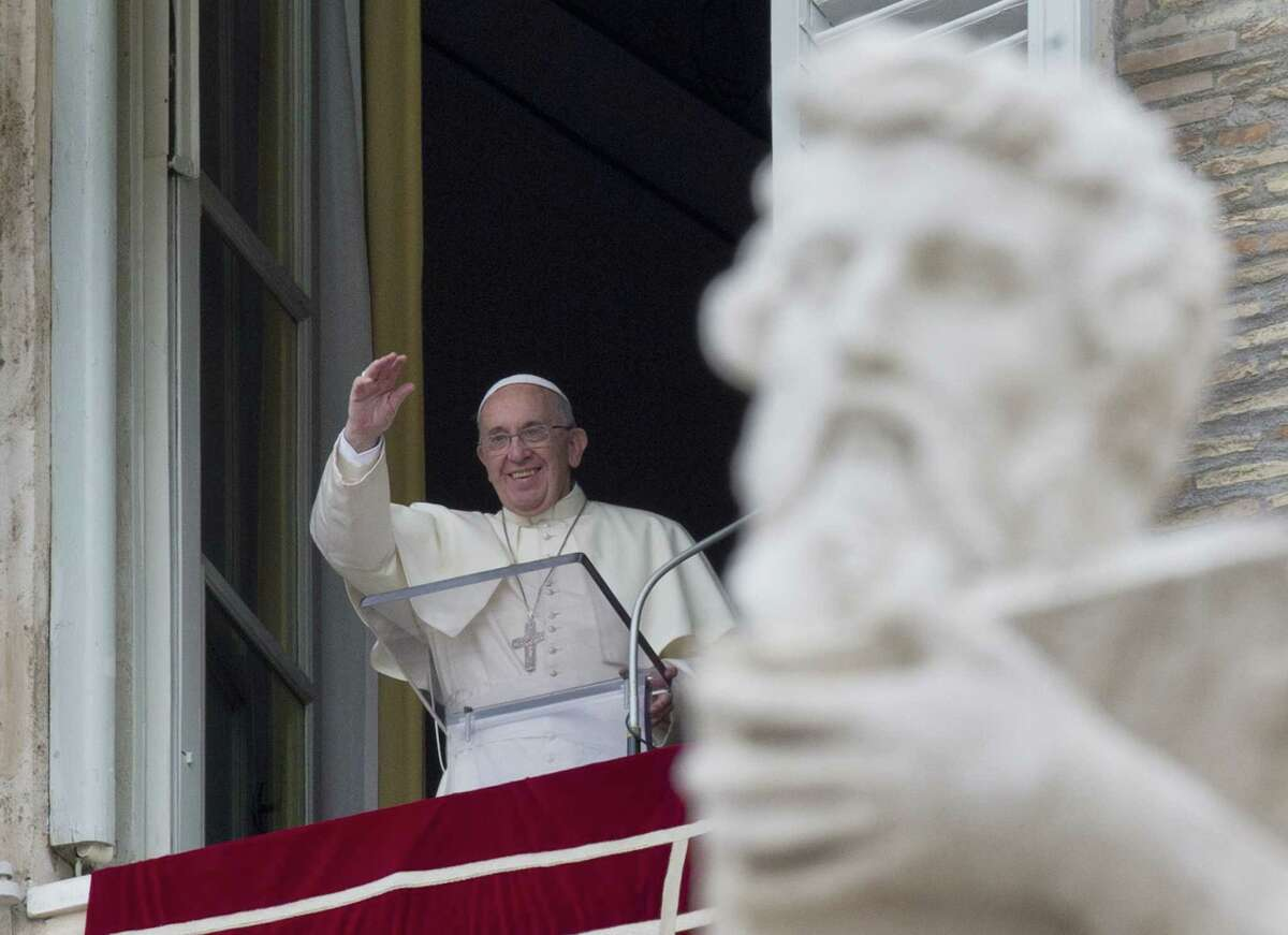Pope Francis delivers his blessing from the window of his studio overlooking St. Peter's Square during the Angelus noon prayer at the Vatican on Sunday, Aug. 16, 2015.