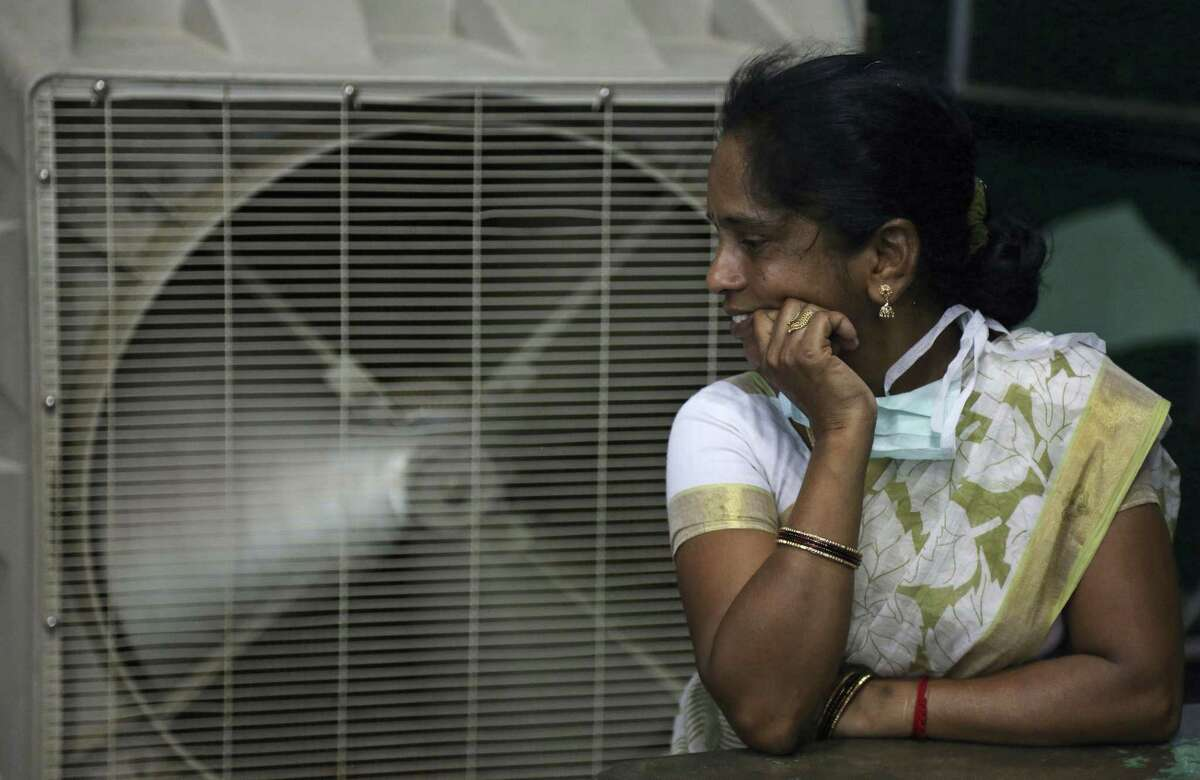 In this May 31, 2015 photo, a woman cools herself on a hot summer day in Hyderabad, in the southern Indian state of Telangana. The U.N. weather agency said on Nov. 14, 2016 that 2016 is set to break the record for the hottest year since measurements began in the 19th century.