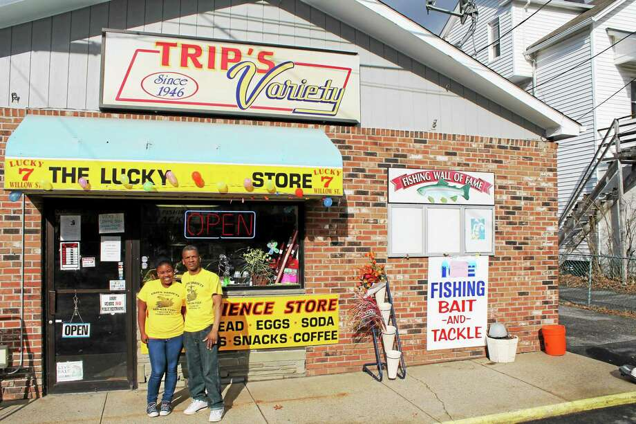 Store owner Miguel Castillo and his daughter, Jeicy Castillo, outside Trip's Variety store in Torrington, which recently reopened. Photo: John Nestor — Special To The Register Citizen