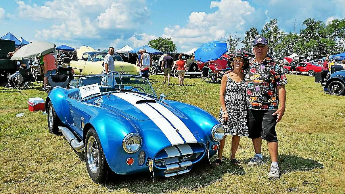 N.F. Ambery photo Don and Joan Marie Cyr of Oakville were on hand to answer questions from passers-by about their bright-blue-with-white-racing-stripe 1966 AC Cobra Model 427 at the 40th Annual Auto Show & Swap Meet in Goshen.