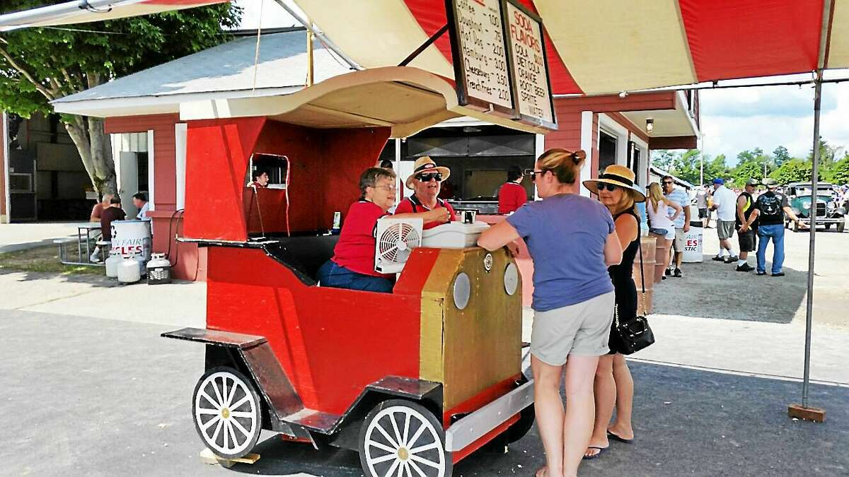 N.F. Ambery photo Volunteer members of the Litchfield Hills Historical Auto Club sell refreshments at the 40th Annual Auto Show & Swap Meet.