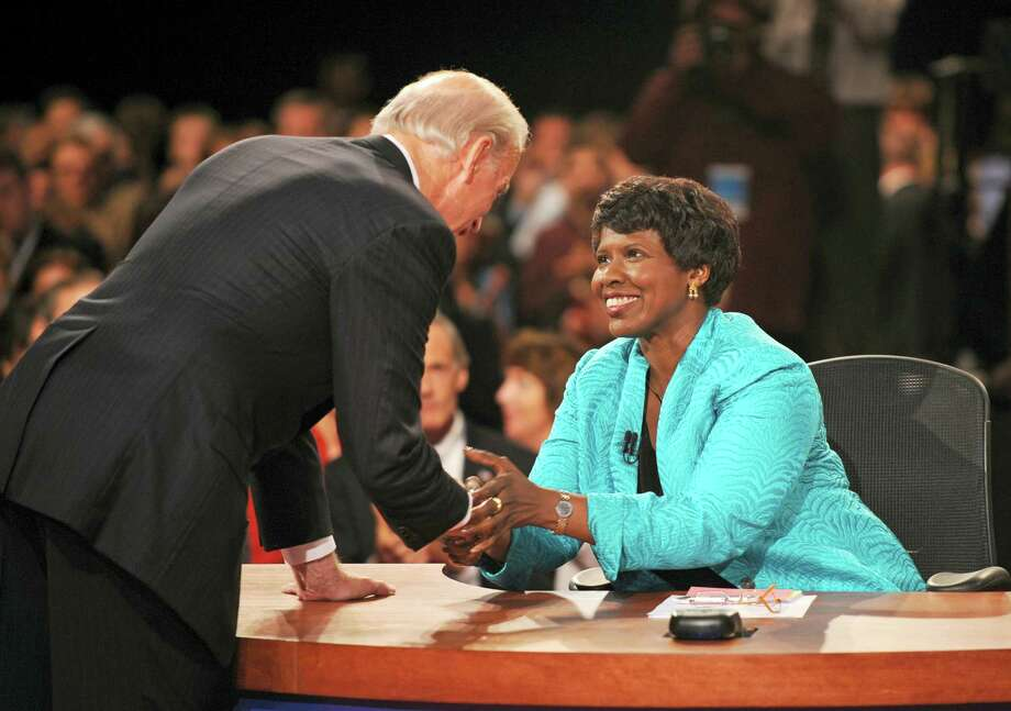 In this file photo, PBS journalist and debate moderator Gwen Ifill and then-Democratic vice presidential nominee, Sen. Joe Biden, D-Del., left, shake hands at the end of his vice presidential debate with Republican rival, Alaska Gov. Sarah Palin in St. Louis, Mo. Ifill died on Monday of cancer, PBS said. She was 61. Photo: Don Emmert — The Associated Press File  / AFP