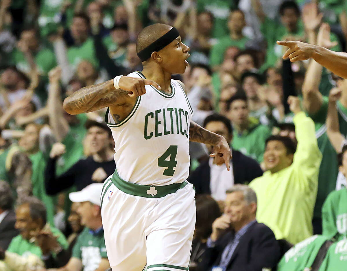 Isaiah Thomas reacts after hitting a 3-pointer against the Hawks on Friday.