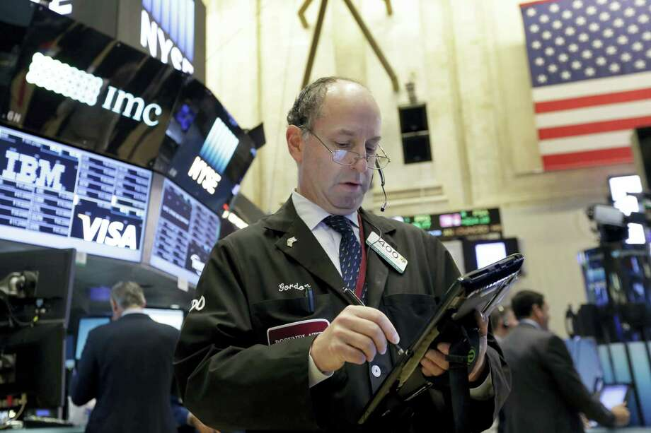 Trader Gordon Charlop works on the floor of the New York Stock Exchange Monday. Photo: Richard Drew — The Associated Press  / AP