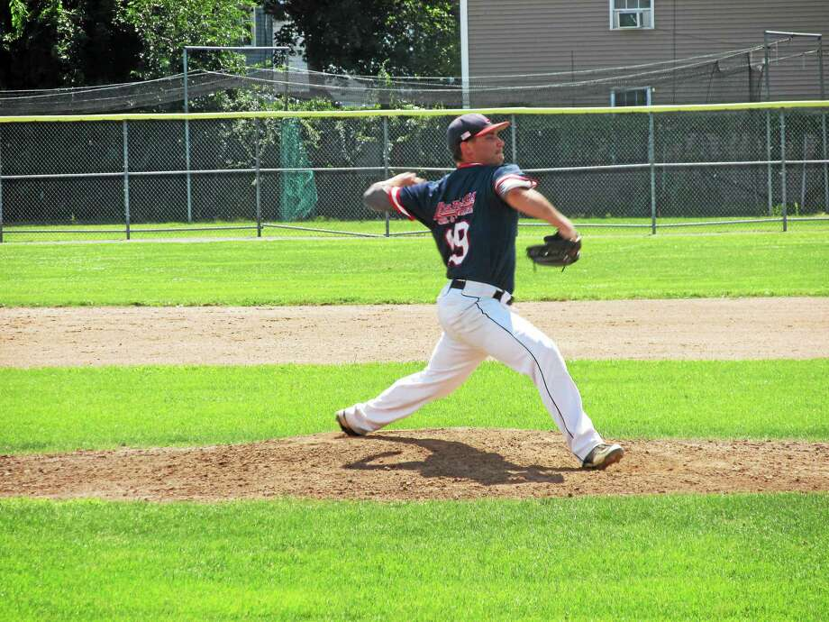Litchfield's Chris Blazek winds up during Game 2 of a Tri-State semifinal against Watertown on at Fuessenich Park. Photo: Peter Wallace — Register Citizen