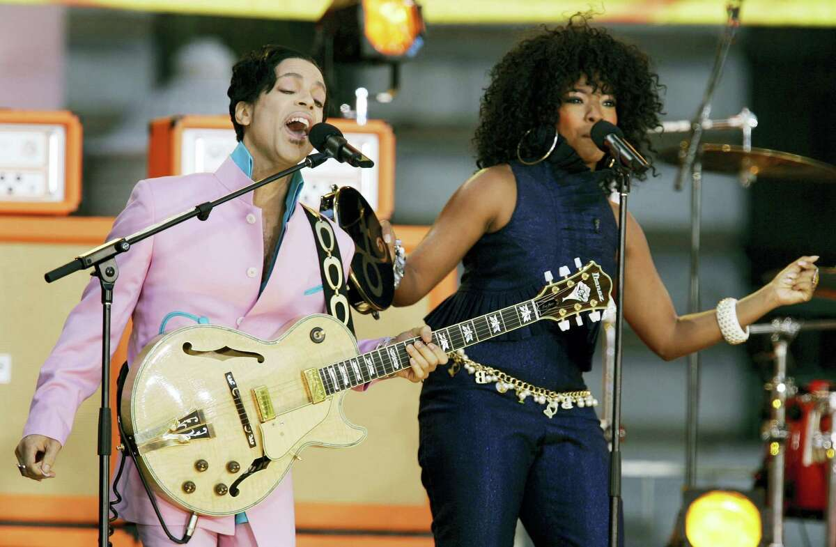 """Musician Prince performs on stage with singer Tamar during ABC's """"Good Morning America"""" summer concert series in New York, Friday, June 16, 2006."""