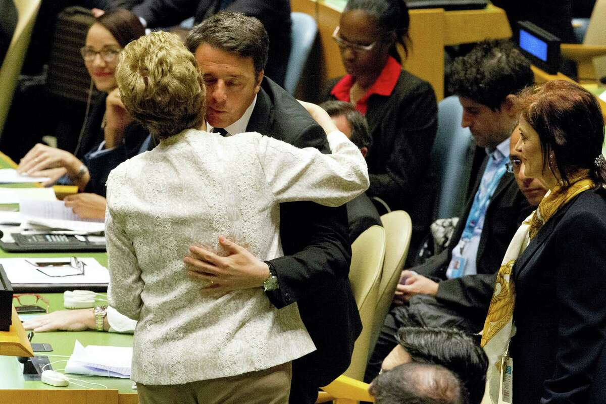 Brazilian President Dilma Rousseff greets Italian Prime Minister Matteo Renzi during the Paris Agreement on climate change ceremony, Friday, April 22, 2016 at U.N. headquarters.