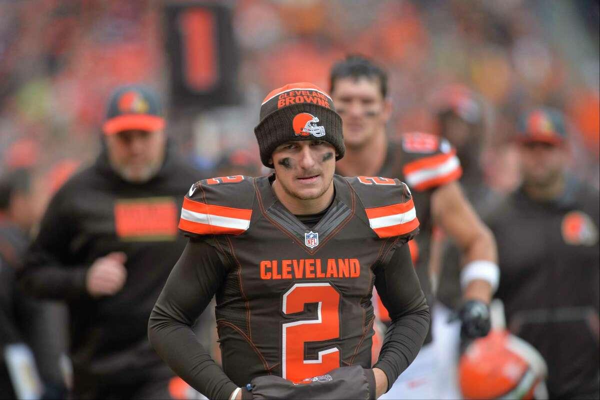 Browns quarterback Johnny Manziel walks off the field Sunday in Cleveland.
