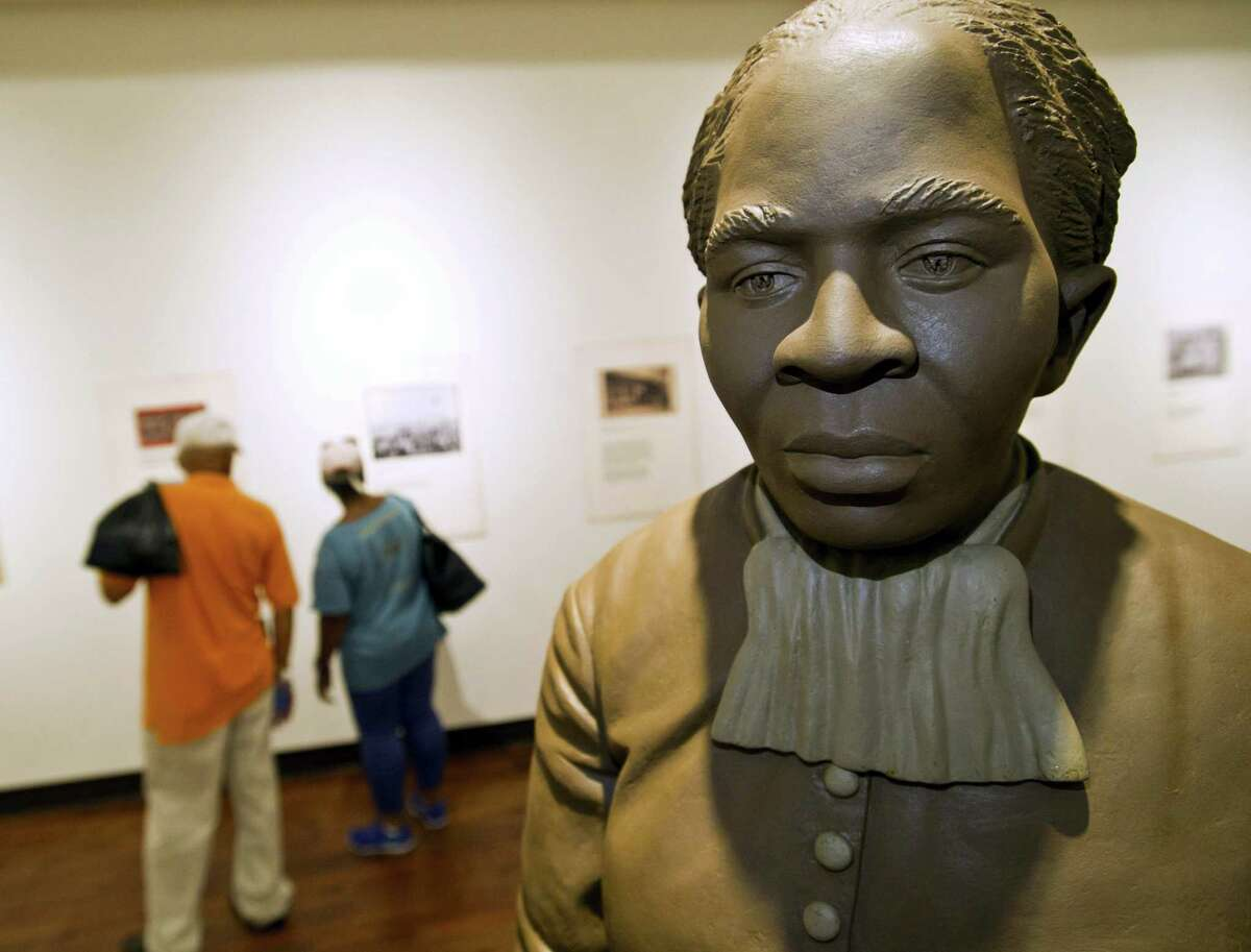 A statue of Harriet Tubman is the centerpiece of the History Gallery at the Tubman Museum in Macon, Georgia. Tubman, a prominent anti-slavery activist, will be the first African American to appear on an American banknote and the first woman to appear on one in a century. Ezzell and Beverly Hart Pittman from Columbia, South Carolina, visit the museum Wednesday afternoon.