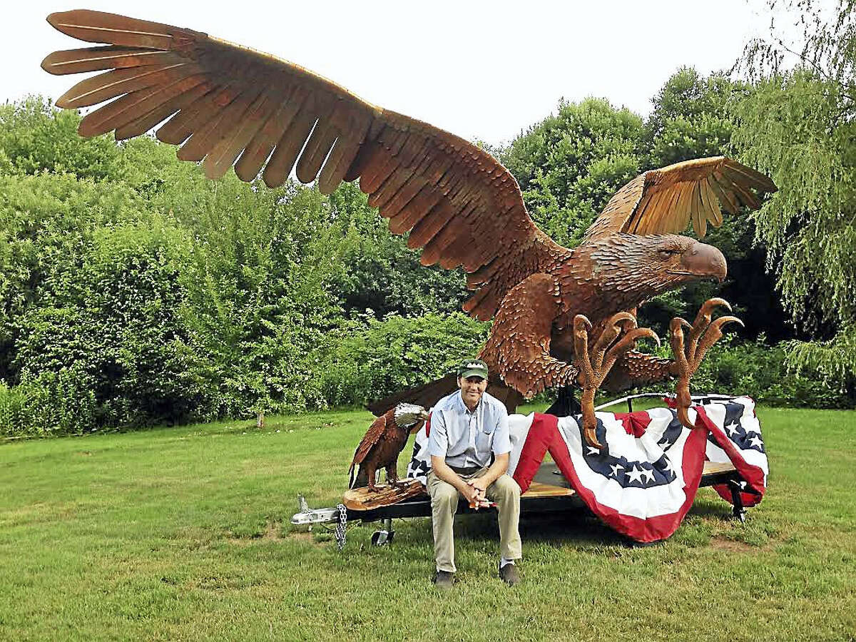 Contributed photoRay white sites with two of his eagle sculptures.