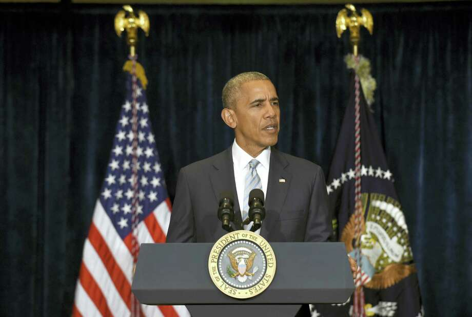 President Barack Obama makes a statement on the fatal police shootings of two black men in Louisiana and Minnesota after arriving in Warsaw, Poland. Photo: AP Photo — Susan Walsh / Copyright 2016 The Associated Press. All rights reserved. This material may not be published, broadcast, rewritten or redistribu