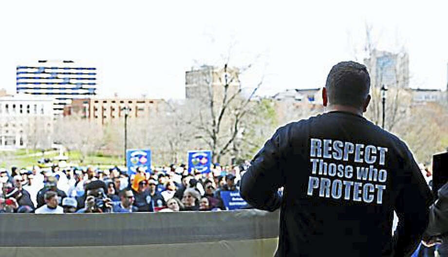 Public safety workers rally at the state Capitol at the end of March. Photo: Christine Stuart File Photo