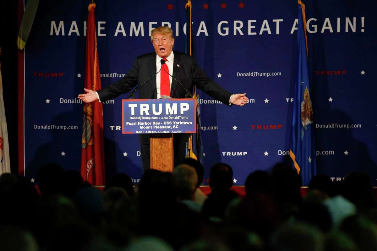 """Republican presidential candidate, businessman Donald Trump, speaks during a rally coinciding with Pearl Harbor Day at Patriots Point aboard the aircraft carrier USS Yorktown in Mt. Pleasant, S.C., Monday, Dec. 7, 2015. Trump defended his plan, Tuesday, Dec. 8, 2015, for a """"total and complete shutdown of Muslims entering the United States"""" by comparing it with President Franklin Roosevelt's decision to inter Japanese Americans during World War II."""