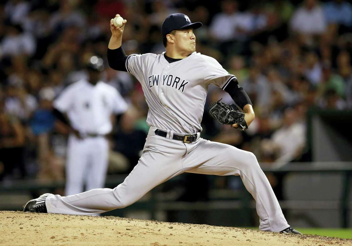 New York Yankees pitcher Masahiro Tanaka delivers during the seventh inning of a baseball game against the Chicago White Sox in Chicago, Tuesday, July 5, 2016. (AP Photo/Jeff Haynes)