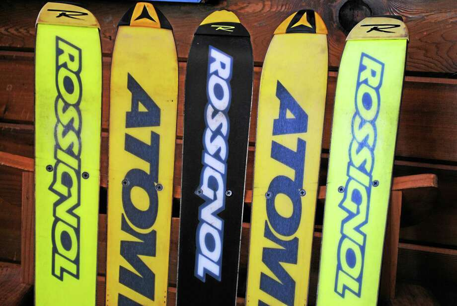 Rossignol and Atomic skis make up the back of a chair at the Ski Haus shop in New Milford. Photo: Photo By Viktoria Sundqvist