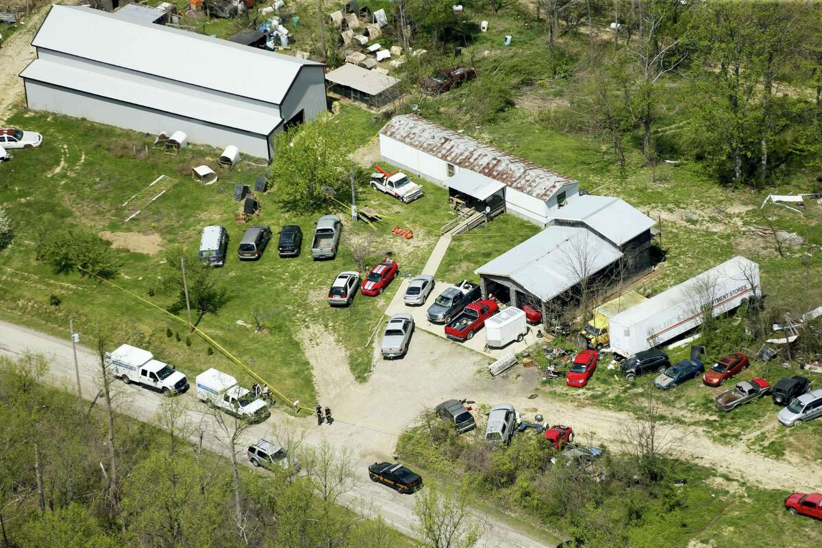 This aerial photo shows one of the locations being investigated in Pike County, Ohio, as part of an ongoing homicide investigation, Friday, April 22, 20156. Several people were found dead Friday at multiple crime scenes in rural Ohio, and at least most of them were shot to death, authorities said. No arrests had been announced, and it's unclear if the killer or killers are among the dead.