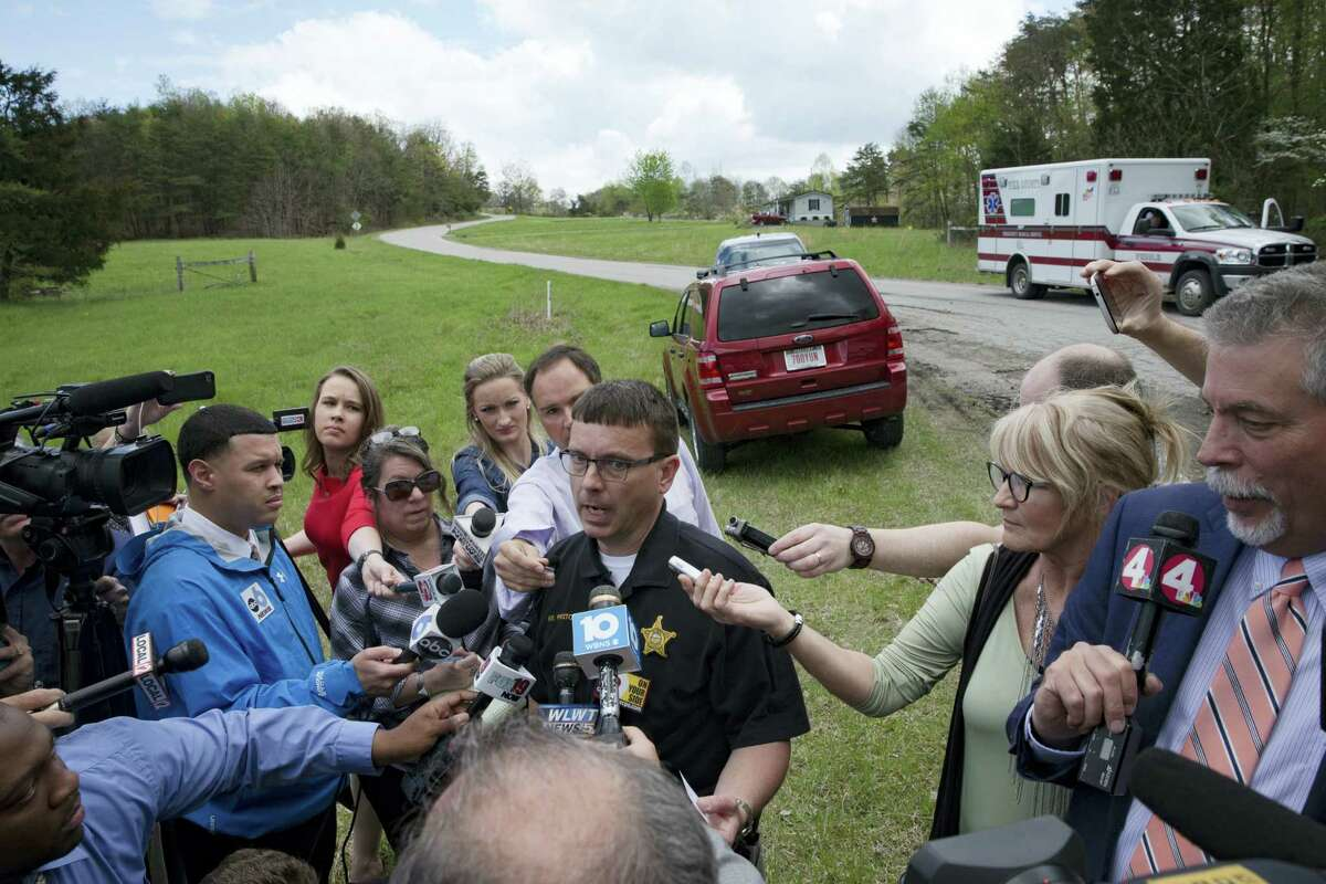 Lt. Michael Preston, of the Ross County Sheriff's Department speaks to the media on Union Hill Road that approaches a crime scene, Friday, April 22, 2016, in Pike County, Ohio. Shootings with multiple fatalities were reported along the road in rural Ohio on Friday morning, but details on the number of deaths and the whereabouts of the suspect or suspects weren't immediately clear. The attorney general's office said a dozen Bureau of Criminal Investigation agents had been called to Pike County, an economically struggling area in the Appalachian region some 80 miles east of Cincinnati.