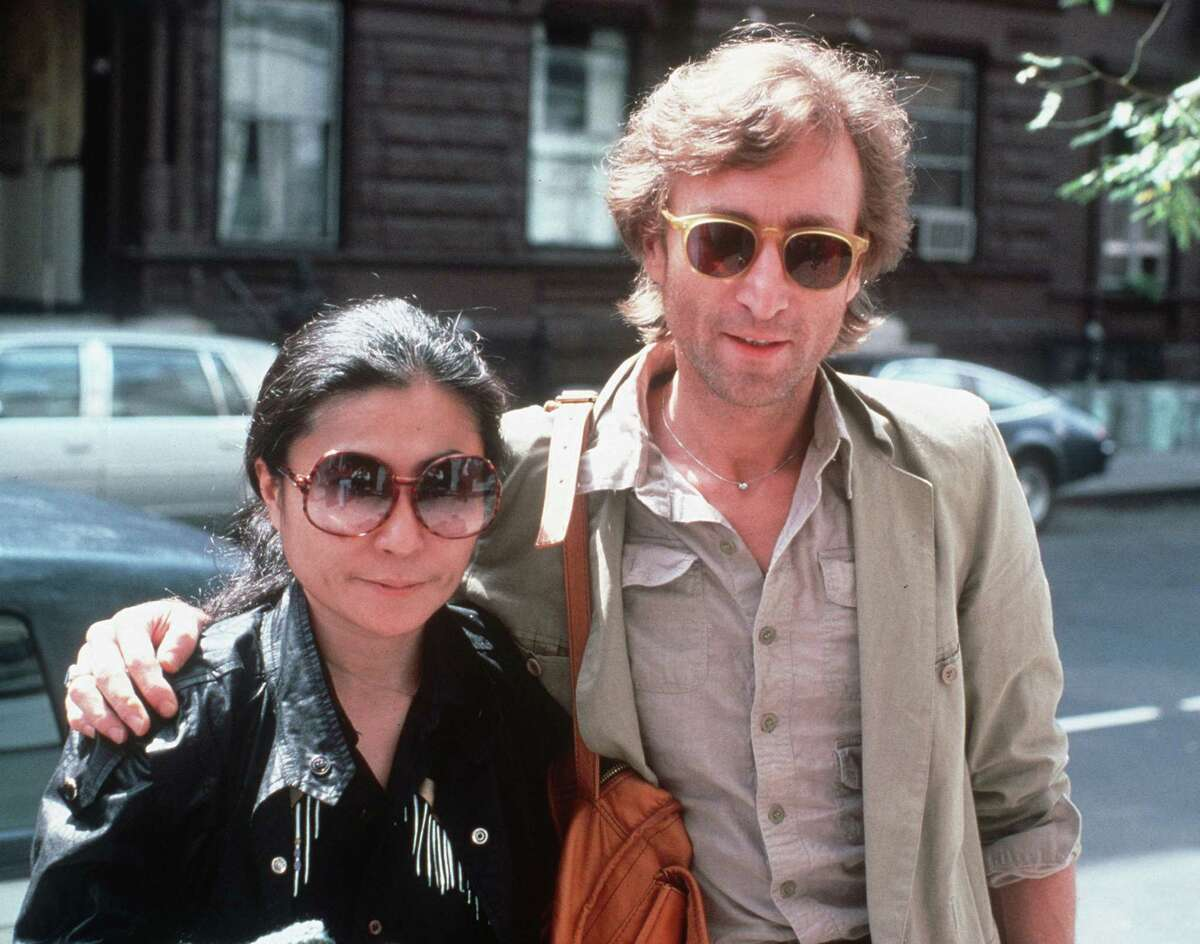 In this Aug. 22, 1980, file photo, John Lennon, right, and his wife, Yoko Ono, arrive at The Hit Factory, a recording studio in New York City. The death of Lennon, shot 35 years ago, still reverberates as a defining moment for a generation and for the music world.