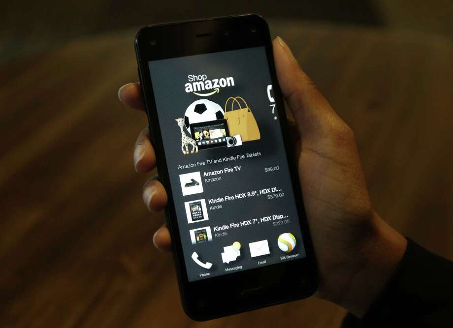 The app that links to shopping on Amazon.com on the Amazon Fire Phone, in Seattle. Photo: Ted S. Warren — The Associated Press  / AP