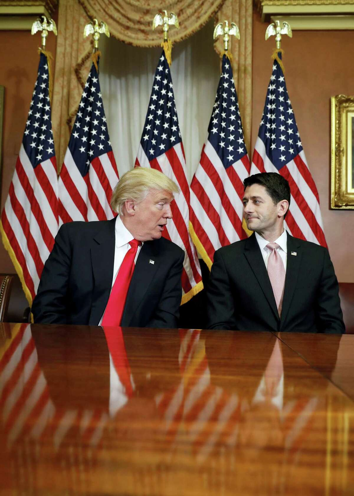 President-elect Donald Trump talks with House Speaker Paul Ryan of Wis. on Capitol Hill in Washington on Nov. 10, 2016.