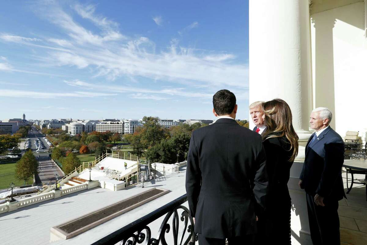House Speaker Paul Ryan of Wis. shows President-elect Donald Trump, his wife Melania and Vice president-elect Mike Pence the view of the inaugural stand that is being built and Pennsylvania Avenue from the Speaker's Balcony on Capitol Hill in Washington on Nov. 10, 2016.