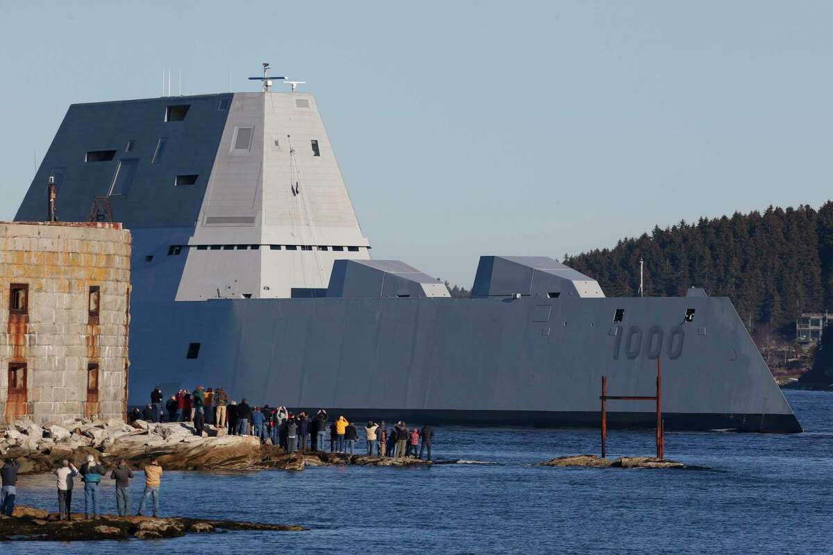 The first Zumwalt-class destroyer, USS Zumwalt, the largest ever built for the U.S. Navy, passes spectators at Fort Popham at the mouth of the Kennebec River in Phibbsburg, Maine on Dec. 7, 2015.
