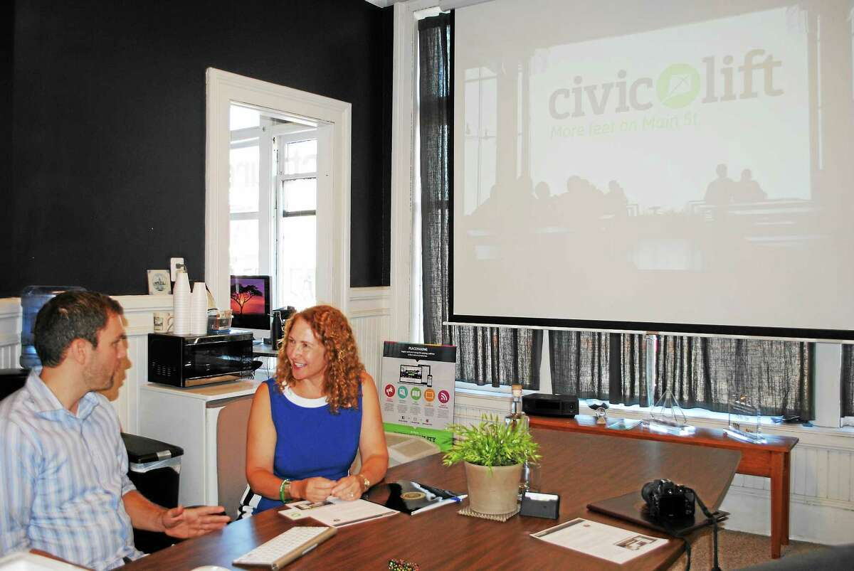 Congresswoman Elizabeth Esty speaks with Evan Dobos about his business, CivicLift, during a visit in Torrington on Thursday.