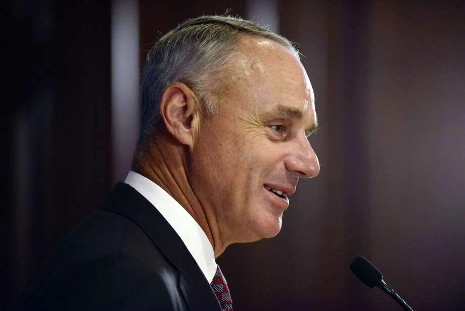 Major League Baseball Commissioner Rob Manfred speaks to the media after the owners meetings on Thursday. Photo: Paul Beaty — The Associated Press  / FR36811 AP