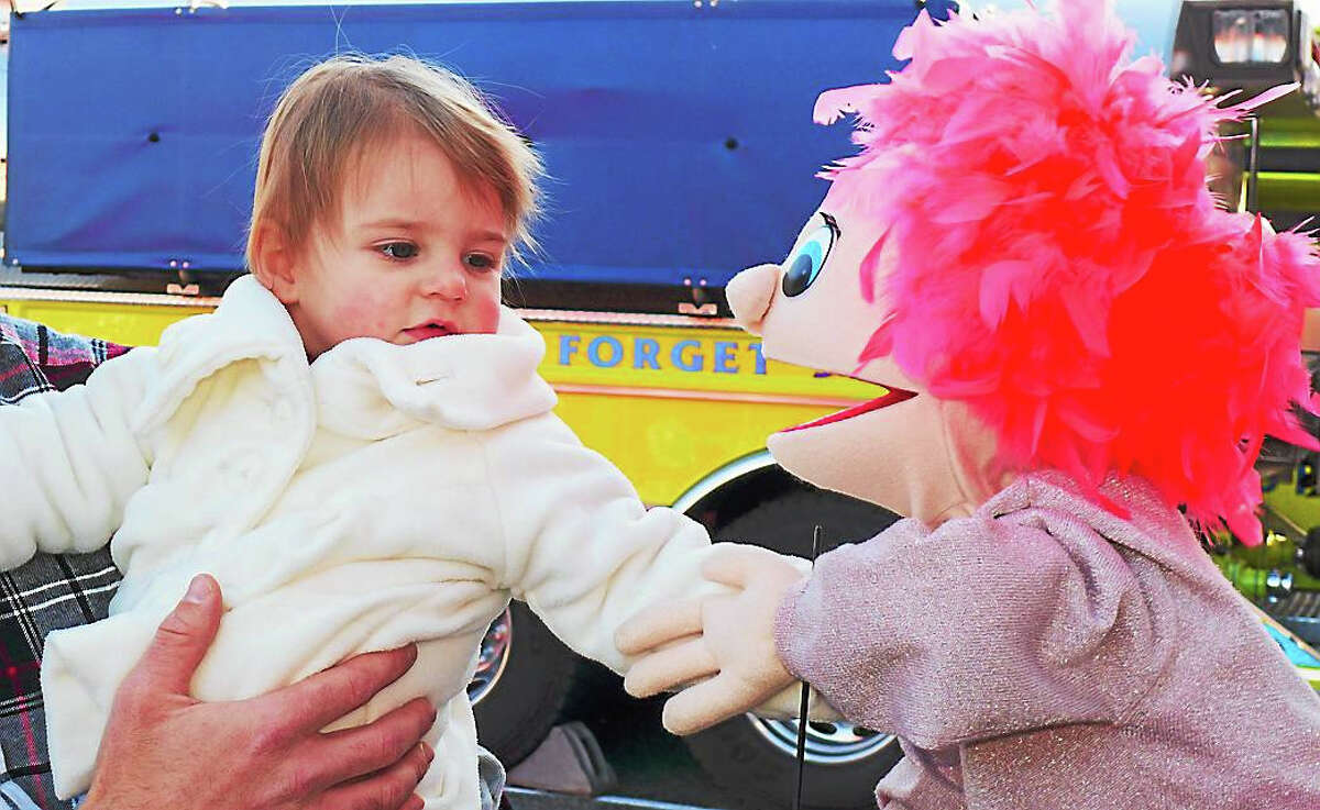 Gwendolyn Hiller, of Colebrook, meets Roxeanne, a star in the puppet Christmas Pageant, produced by Puppets of the King from Faith Bible Church in Winsted and Puppets of Praise, from Praise Christmas Fellowship in Barkhamsted.
