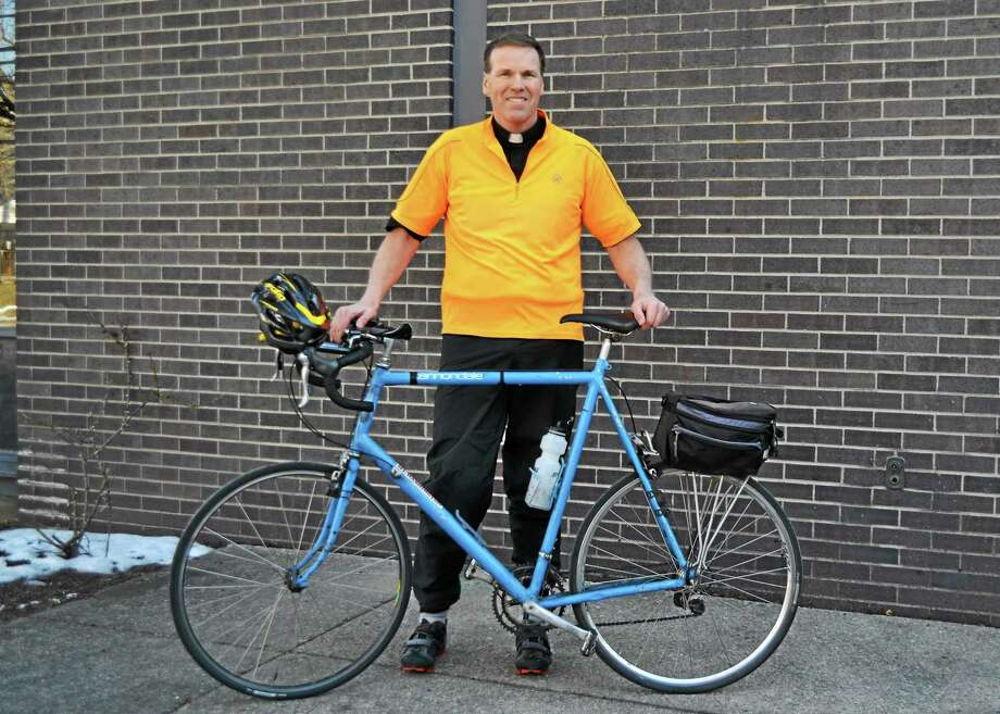 Father Jim Sullivan will bike 350 miles to raise money for St. Peter/St. Francis School in Torrington. Photo: Contributed Photo