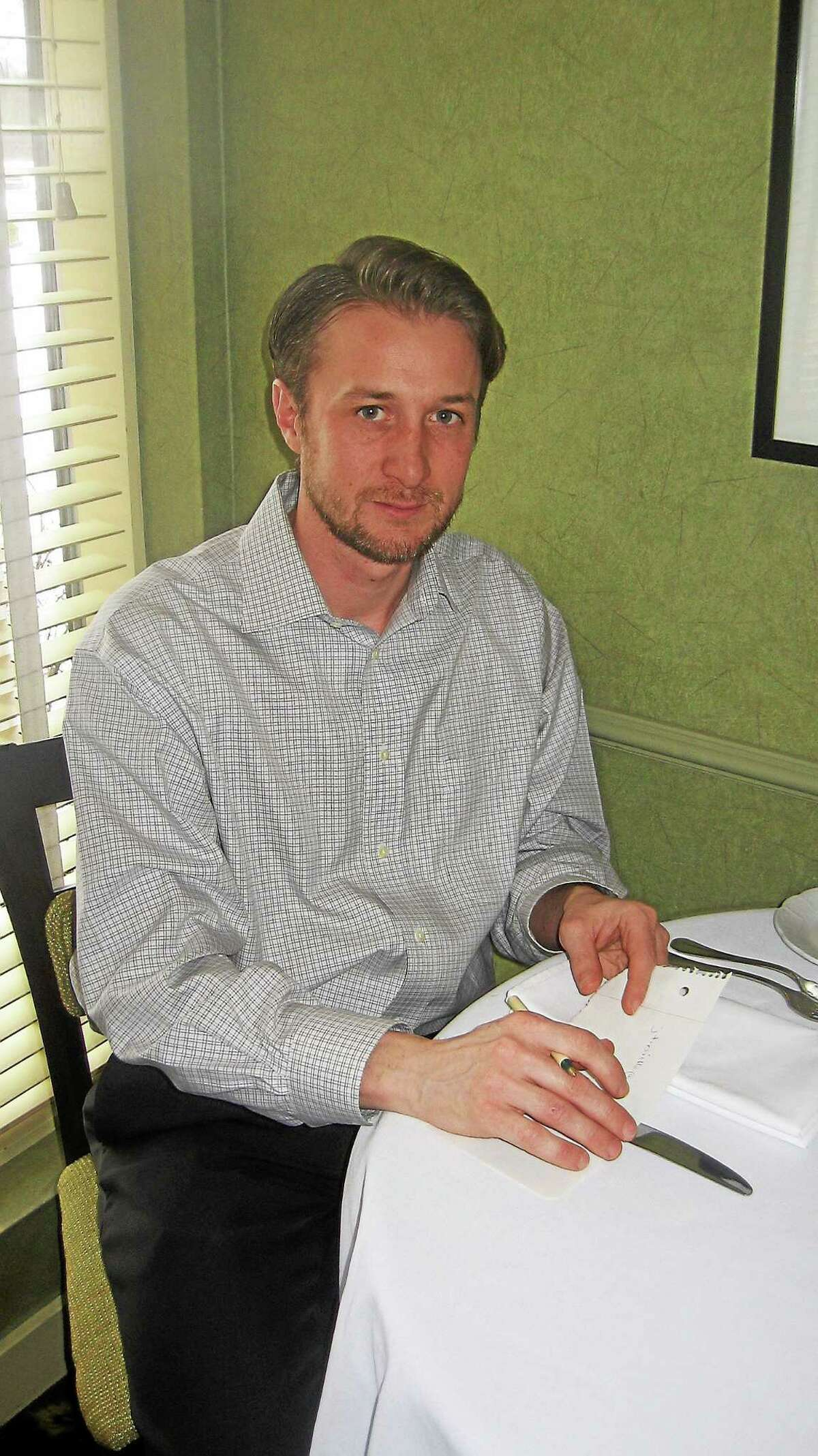Brandon Scimeca, of East Canaan, serves the dual role as executive chef and food and beverage director at Morgan's Restaurant.