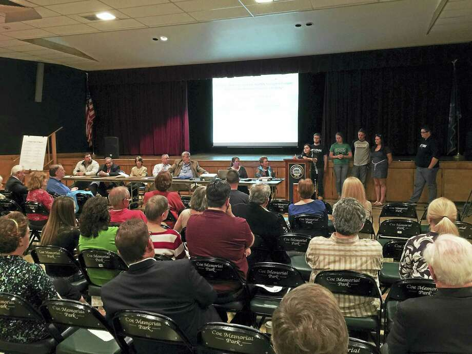 Community residents were urged to make clear their opposition to the potential closure of the UConn-Torrington campus Thursday evening, at a town hall meeting was held. Photo: BEN LAMBERT — REGISTER CITIZEN