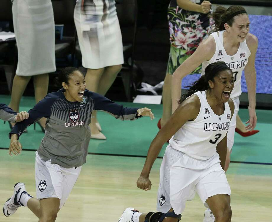 UConn forward Morgan Tuck (3) rushes the court at the conclusion of the Huskies' 63-53 win over Notre Dame on Tuesday in the national championship game in Tampa, Fla. Photo: Chris O'Meara — The Associated Press  / AP