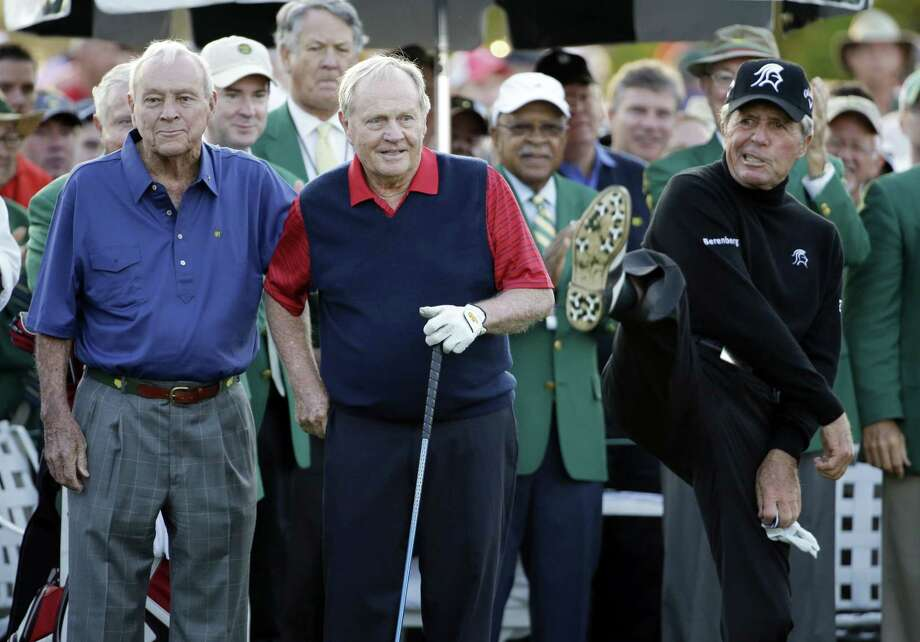 Arnold Palmer and Jack Nicklaus watch as Gary Player kicks the air during the honorary tee-off before the first round of the Masters on Thursday in Augusta, Ga. Photo: David J. Phillip — The Associated Press  / AP