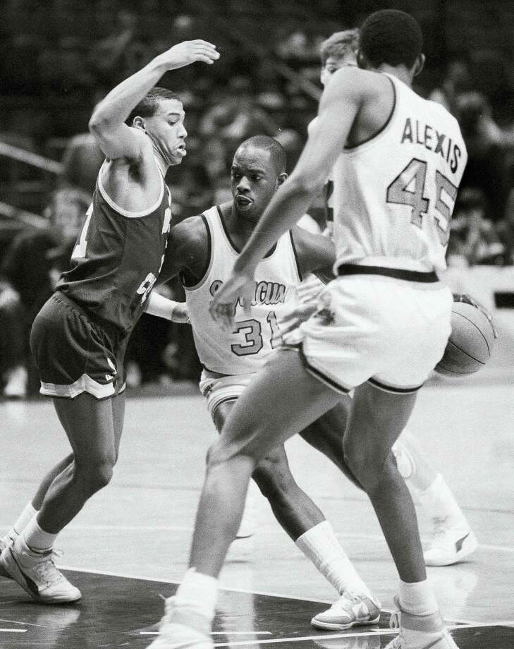 """In this 1986 file photo, Dwayne """"Pearl"""" Washington (31) of Syracuse drives around Boston College's Dana Barros during the Big East tournament. Photo: The Associated Press File Photo  / AP"""
