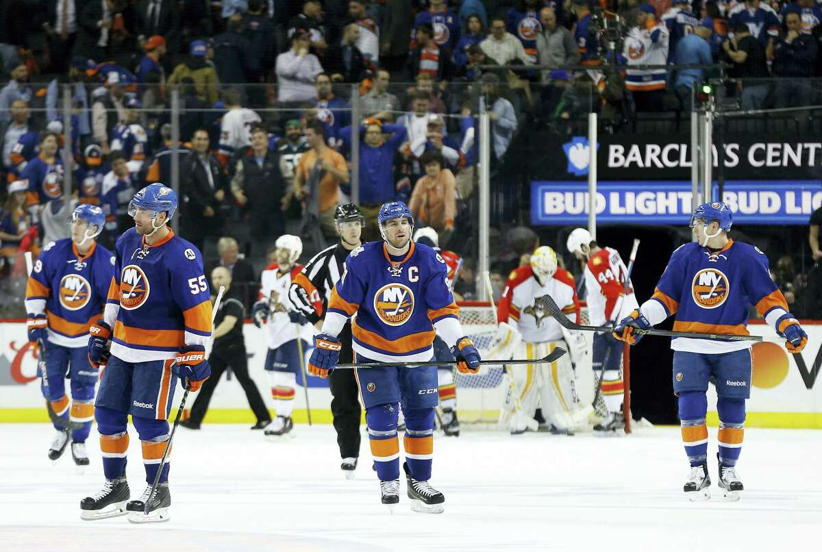 Members of the Islanders skate off the ice after losing to the Florida Panthers in Game 4 of their playoff series.