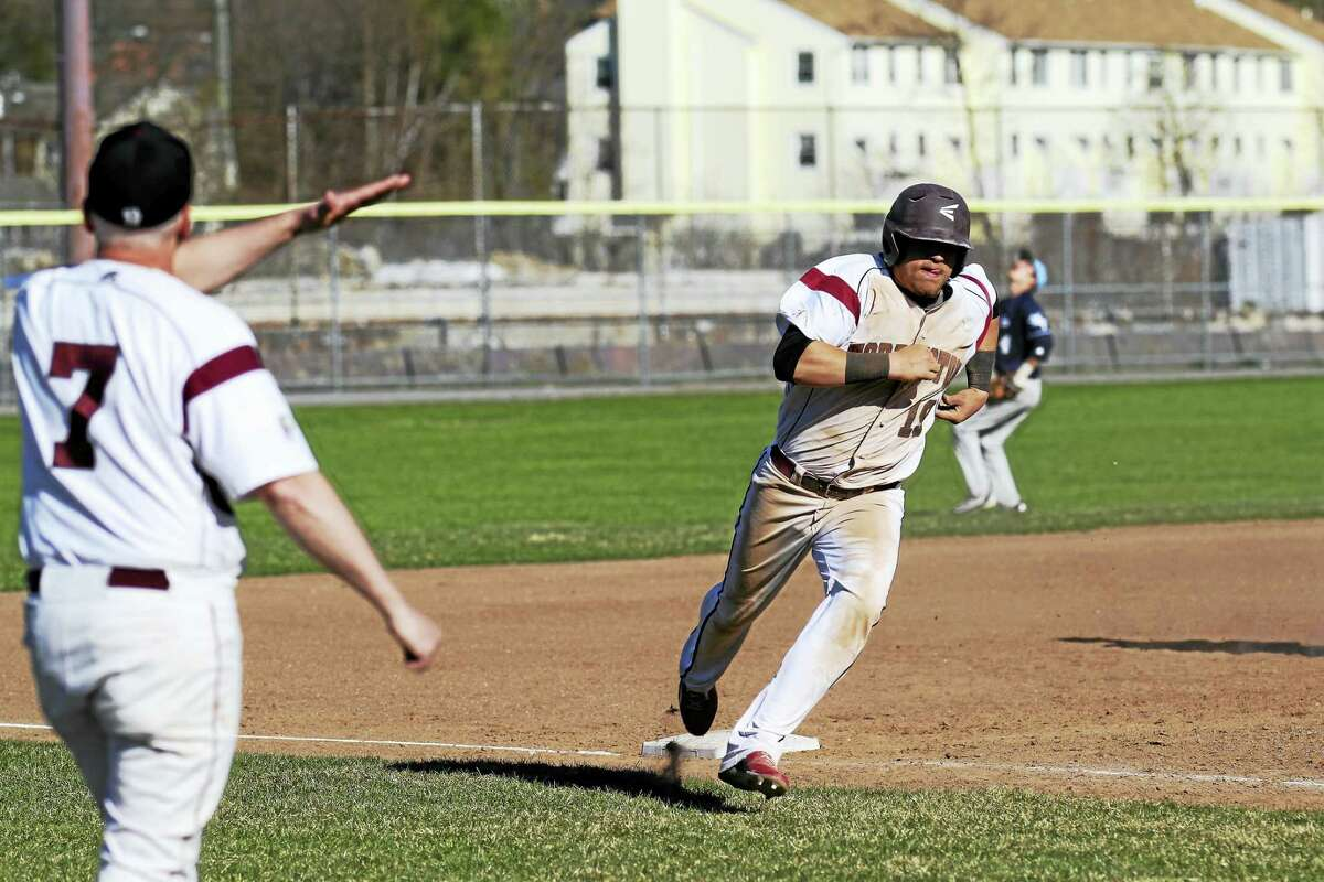 Photo by Marianne KillackeyDom Sabia bursts toward home on a hit by Jason Vinisko in Torrington's big win over Ansonia Wednesday at Fuessenich Park.