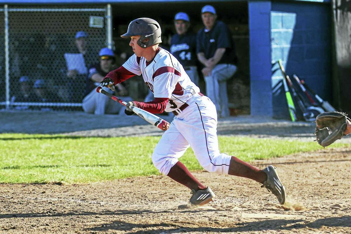 Photo by Marianne KillackeyTorrington's Ben Vanotti got a big Red Raider inning moving with a perfect squeeze bunt in Torrington's combination of speed and power in a win over Ansonia Wednesday at Fuessenich Park.