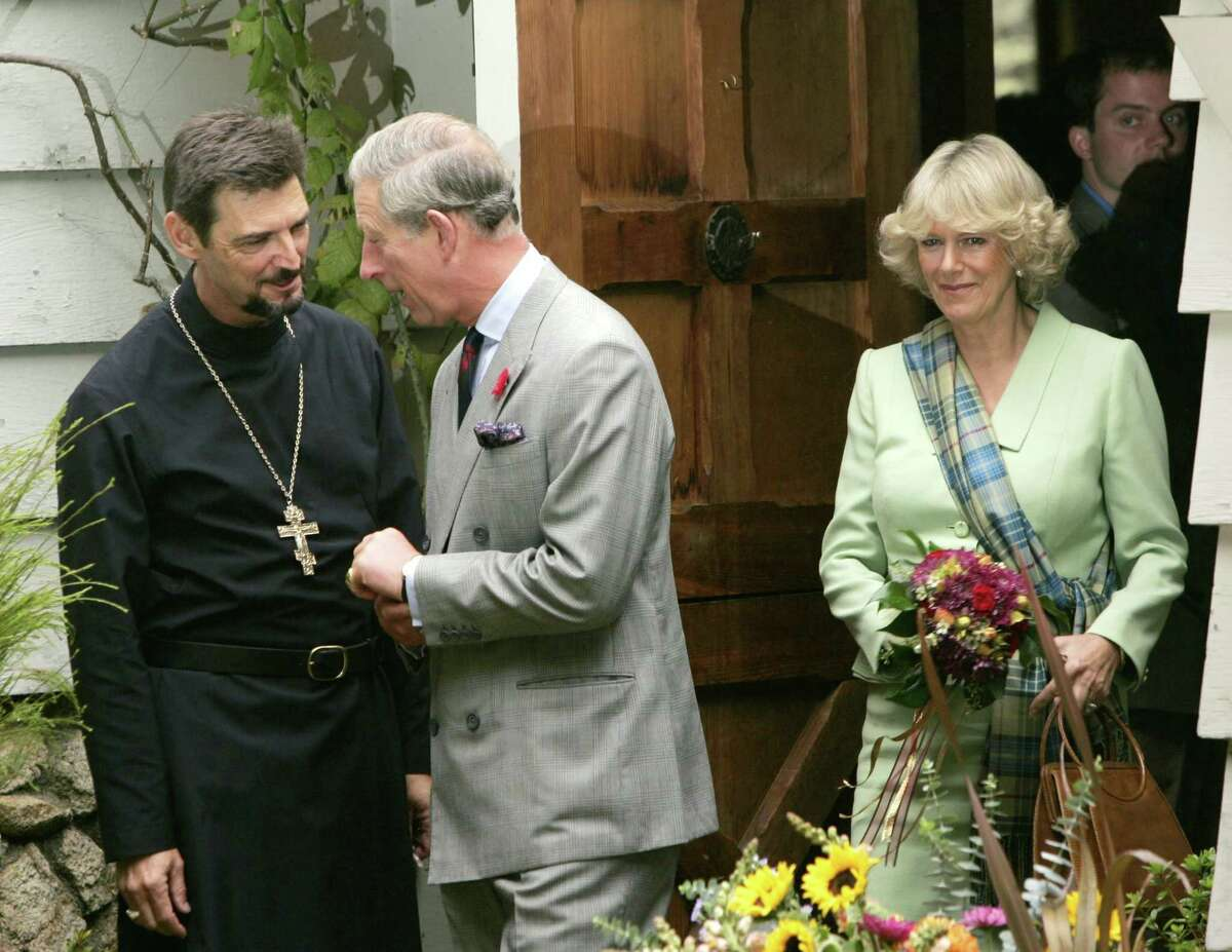 FILE - This is a Sunday Nov. 6, 2005 file photo of Britain's Prince Charles and Camilla Duchess of Cornwall as they walk out with Pastor Tom Brindley after attending church service at St. Columba Episcopal Church in Inverness, Calif. The heir to the British throne and his consort, Camilla, are celebrating 10 years of marriage - a decade in which Camilla's public image has gone from aristocratic home-wrecker to admired addition to the royal family. (AP Photo/Kevork Djansezian, File)