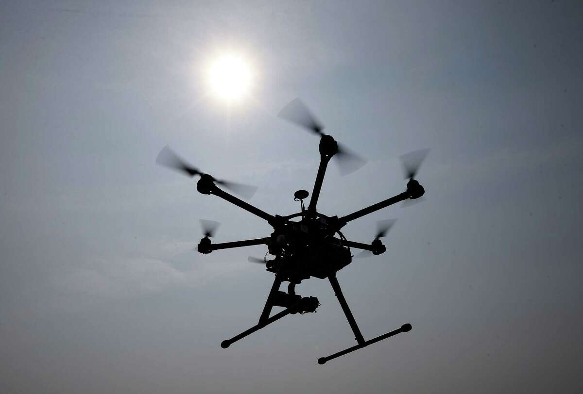In this June 11, 2015, file photo, a hexacopter drone is flown in Cordova, Md. Pilot reports of drone sightings so far this year are more than double last year, the Federal Aviation Administration reported Thursday. There have been more than 650 reports this year by pilots of unmanned aircraft flying near manned aircraft, according to the FAA. There were 238 drone sightings in all of 2014.