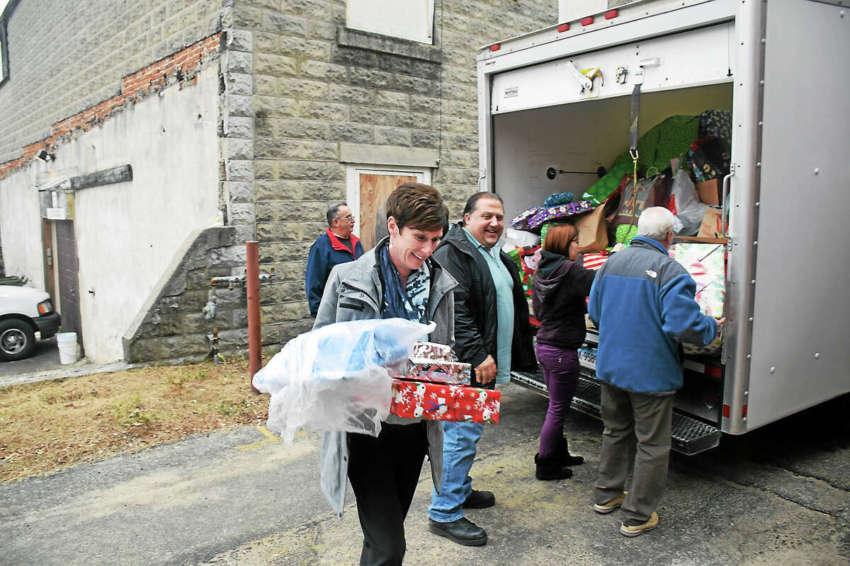 Contribued photoO&G Industries' Lynn Robatham and her team deliver toys to the Torrington Youth Service Bureau. The company received an industry Community Service Award for its outreach efforts including the toy drive.