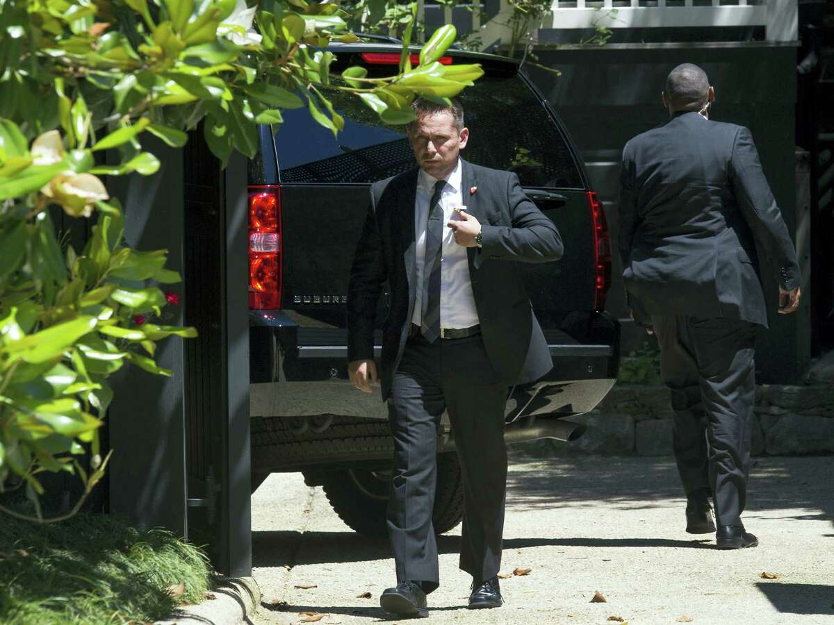 Secret Service stand guard around a Secret Service vehicle after it arrived at the home of Democratic presidential candidate Hillary Clinton in Washington, Saturday, July 2, 2016. The Clinton campaign says the FBI interviewed Clinton on Saturday morning in Washington about her emails while she was secretary of state.