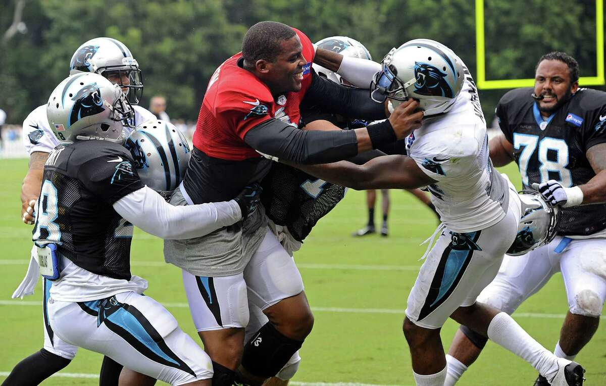 Carolina Panthers quarterback Cam Newton (1), left center, and Josh Norman (24), right center, scuffle at training camp on Monday at Wofford College in Spartanburg, S.C.