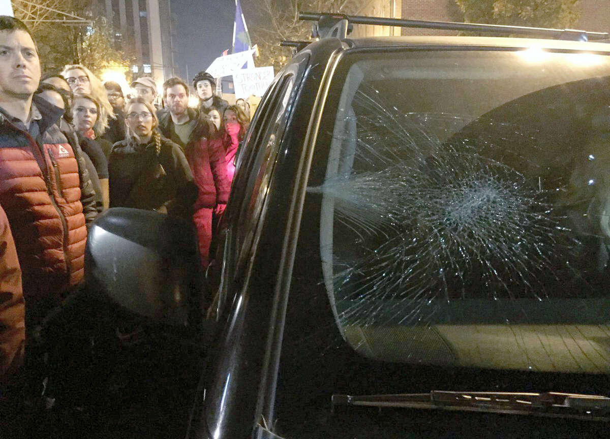 A driver's windshield was damaged after she drove in the area with protesters demonstrating against Tuesday's U.S. presidential election results, Thursday, Nov. 10, 2016, in Portland, Ore. President-elect Donald Trump fired back on social media after demonstrators in both red and blue states hit the streets for another round of protests, showing outrage over the Republican's unexpected win.