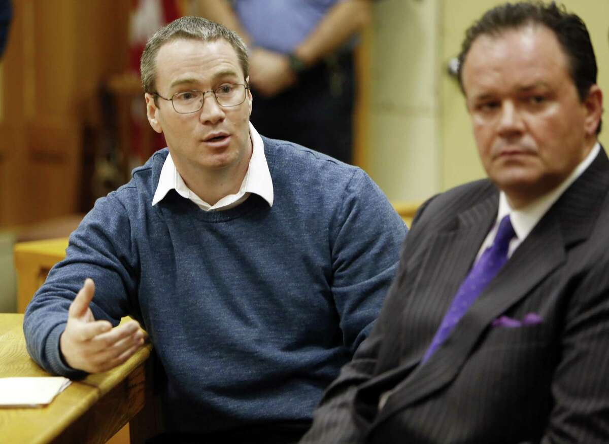 Patrick Randall, left, with his attorney Mark Stevens answers questions from Gregory Smartís family during his parole hearing, Thursday, April 9, 2015, in Concord, N.H. Randall was granted parole for his role in the killing of Gregory Smart in 1990. (AP Photo/Jim Cole)