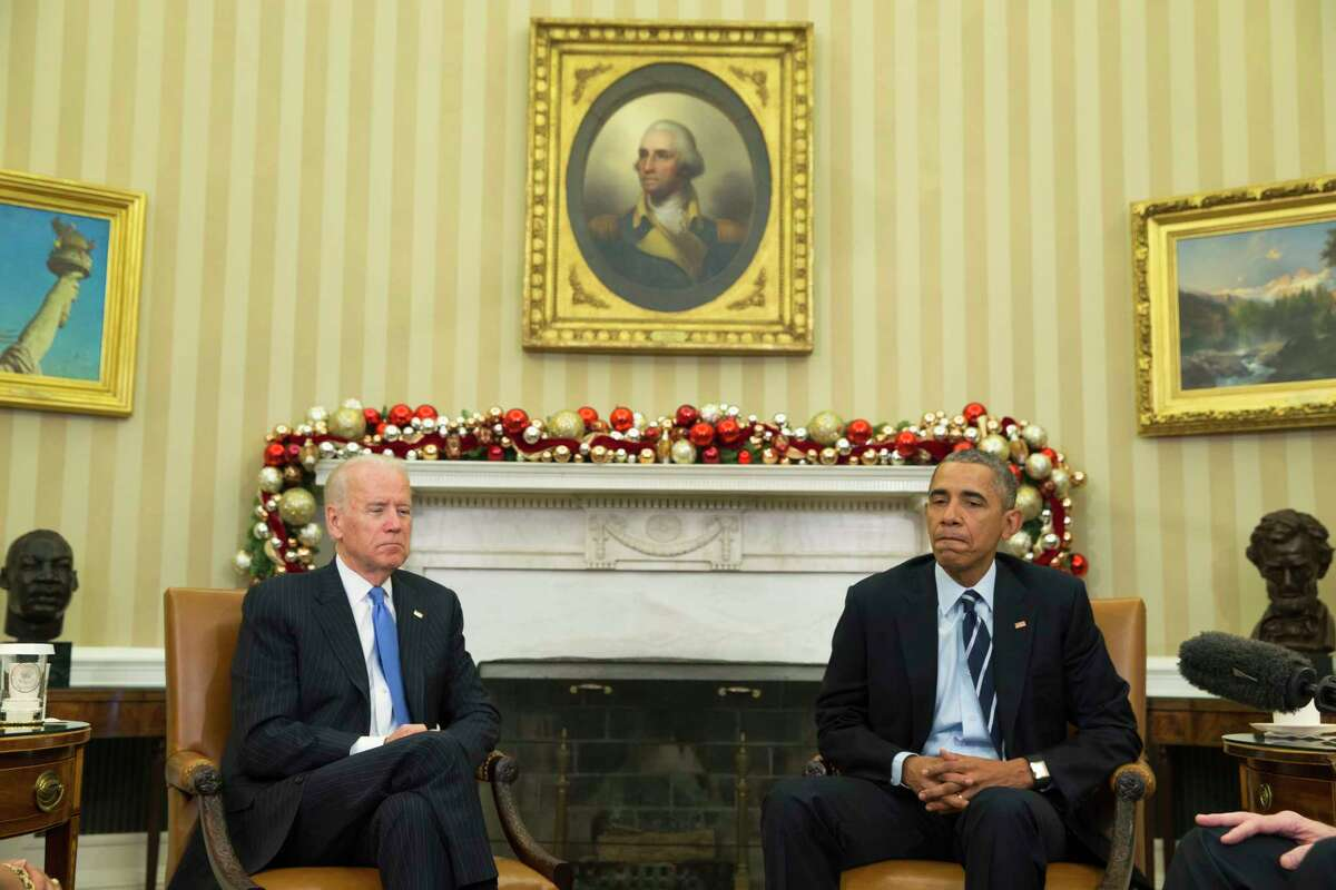 President Barack Obama, accompanied by Vice President Joe Biden, pauses while making a statement on Wednesday's mass shooting in San Bernandino, Calif. on Dec. 3, 2015, in the Oval Office of the White House in Washington.