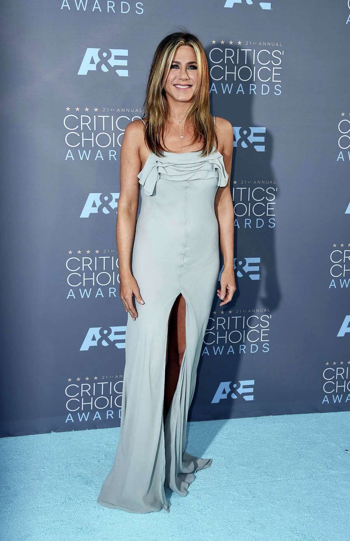 """In this Jan. 17, 2016, file photo, Jennifer Aniston arrives at the 21st annual Critics' Choice Awards at the Barker Hangar in Santa Monica, Calif. People Magazine has named Aniston its """"World's Most Beautiful Woman"""" of 2016. The 47-year-old actress graces the cover of People's 27th annual """"World's Most Beautiful"""" double issue."""