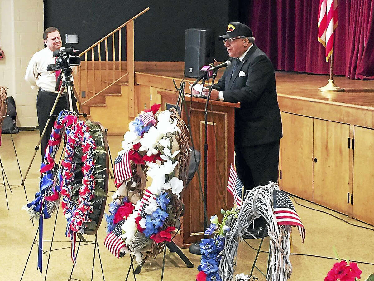 Torrington marked the annual Veterans Day holiday Friday with a ceremony in Coe Memorial Park. Above, Sam Slaiby gives a speech during the program.