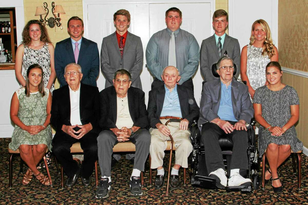 Scholarship winners and VAC founding fathers pose before the banquet. They are: (back row, left to right) Lindsay Trobel, Jack Wassik, Matt Traub, Ben Bonvicini, Tom Killackey, Emmy Fedor. And: (front row, left to right) Shelby Howe; VAC Founding Fathers Lou Zanderigo, Dominic Toce, Frank Russo and Andy Pace; Taylor Howe.